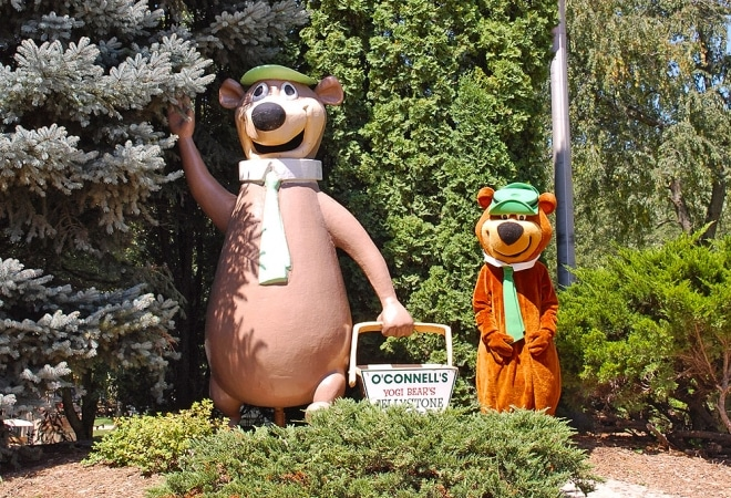 Statues of two bears at a campground.