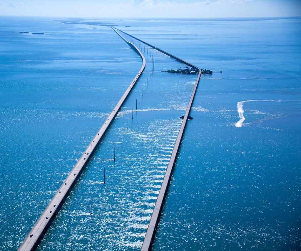 Long bridge stretches across ocean waters.
