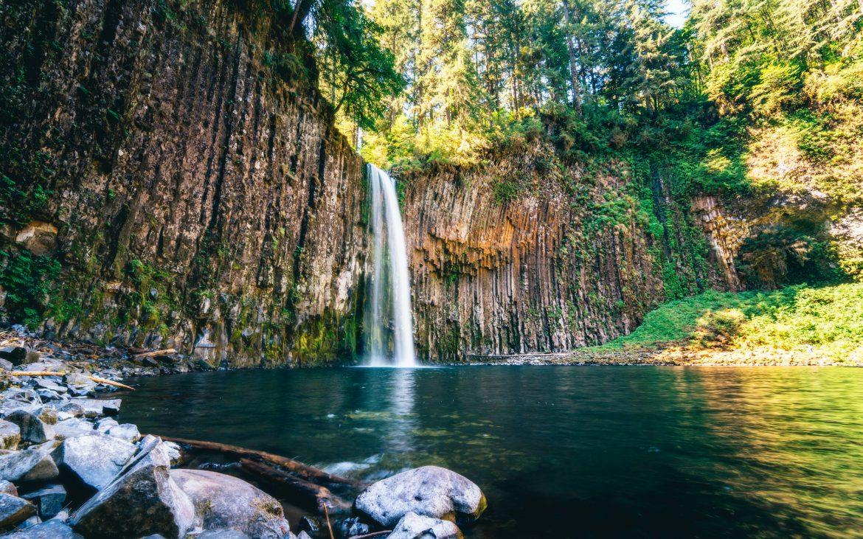 Oregon waterfall falling into turquoise water