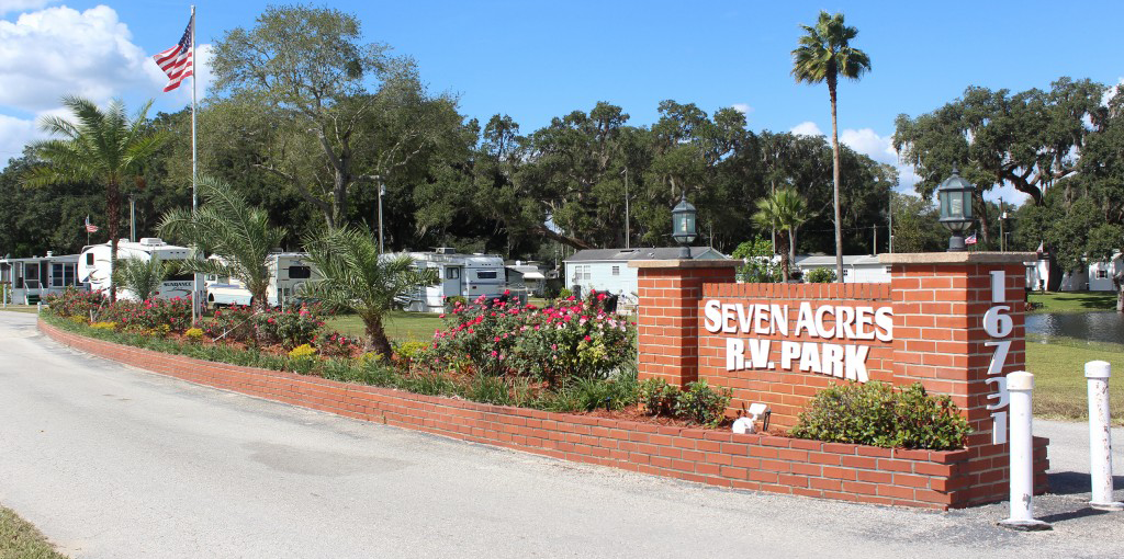 "Brick sign indicating ""Seven Acres R.V. Park"" a new Good Sam Park"