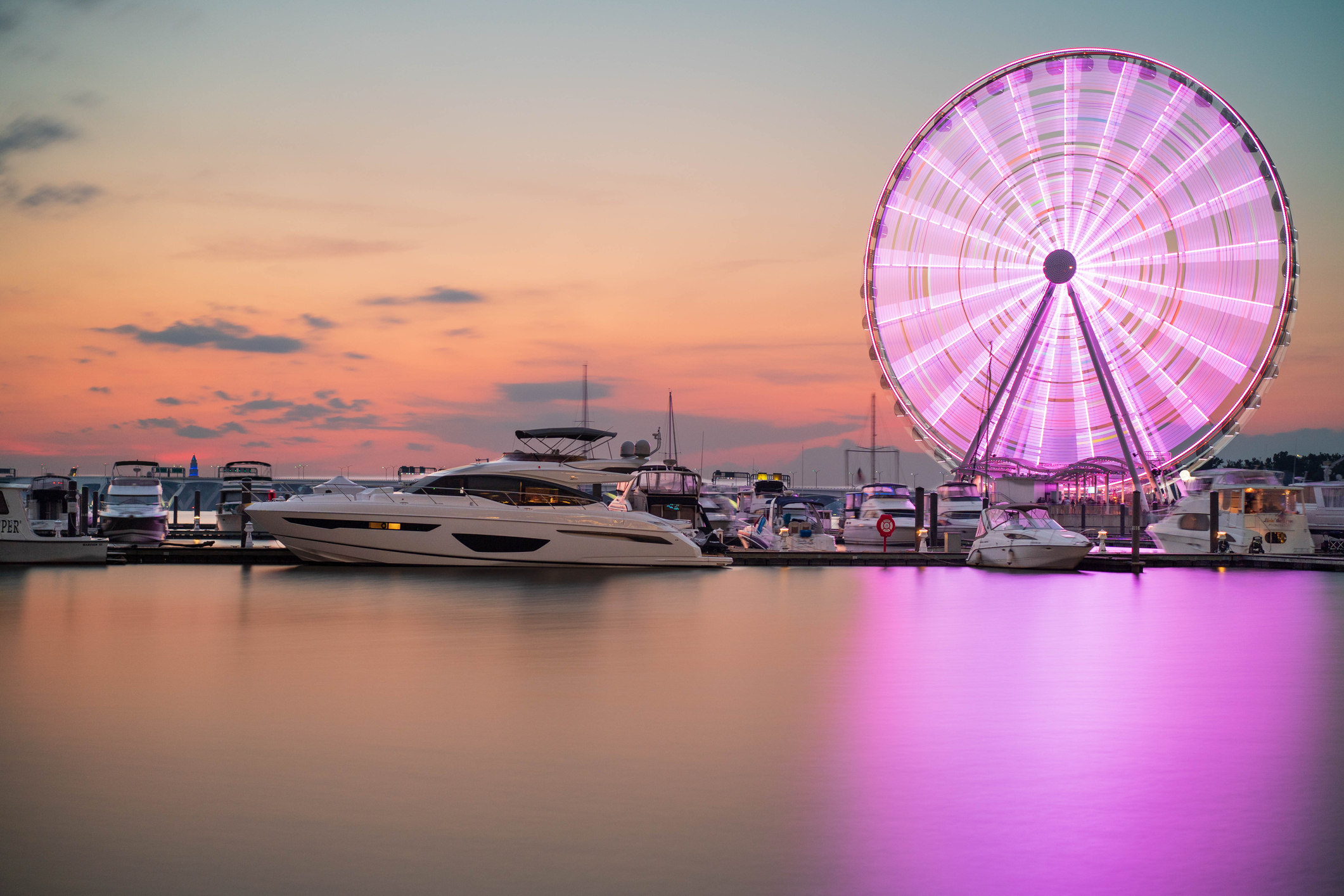 Ferris wheel seen at sunset time at the National Harbor in Oxon Hill, Maryland