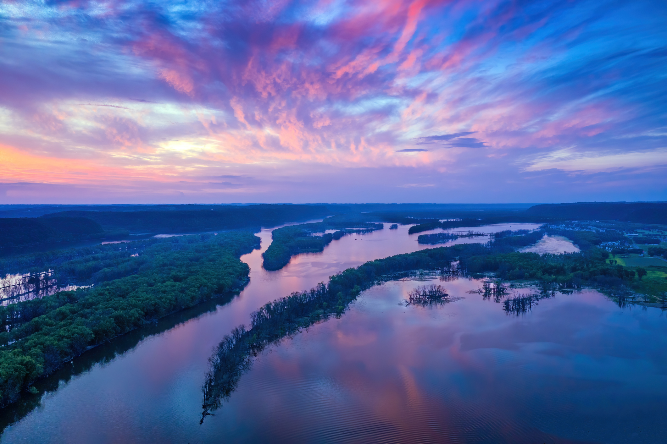 Aerial view of reflections of sunset over islands in the Mississippj River between Iowa and Wisconsin.