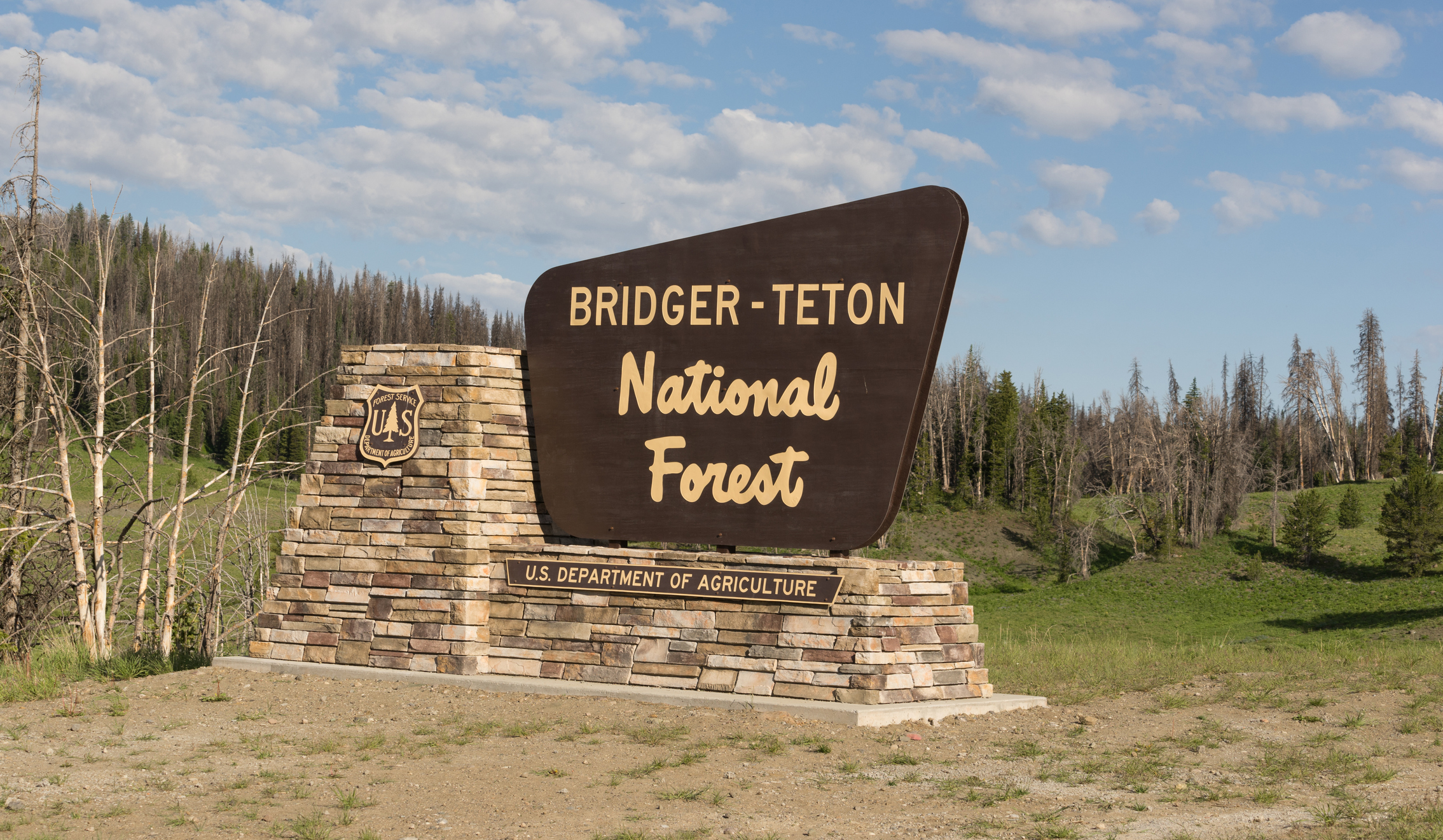 Sign marking the boundary of the Bridger Teton National Forest.