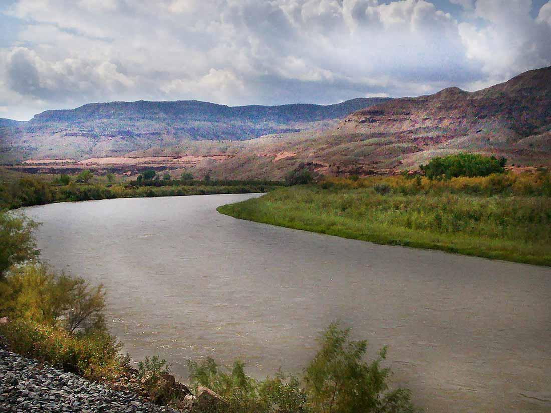 A river follows a curve around a rugged landscape.
