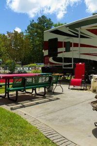 A couple loungin at their campsite.