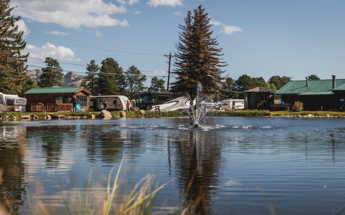 Lake with fountain at Spruce Lake RV Resort in Colorado