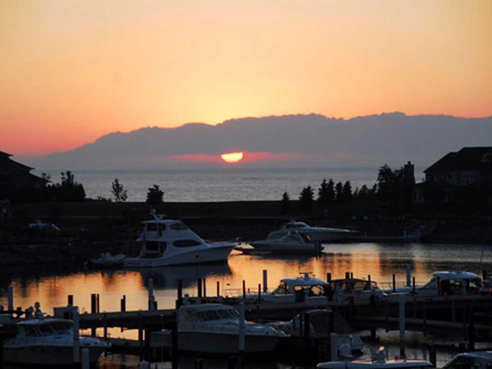 Sun setting over a marina.