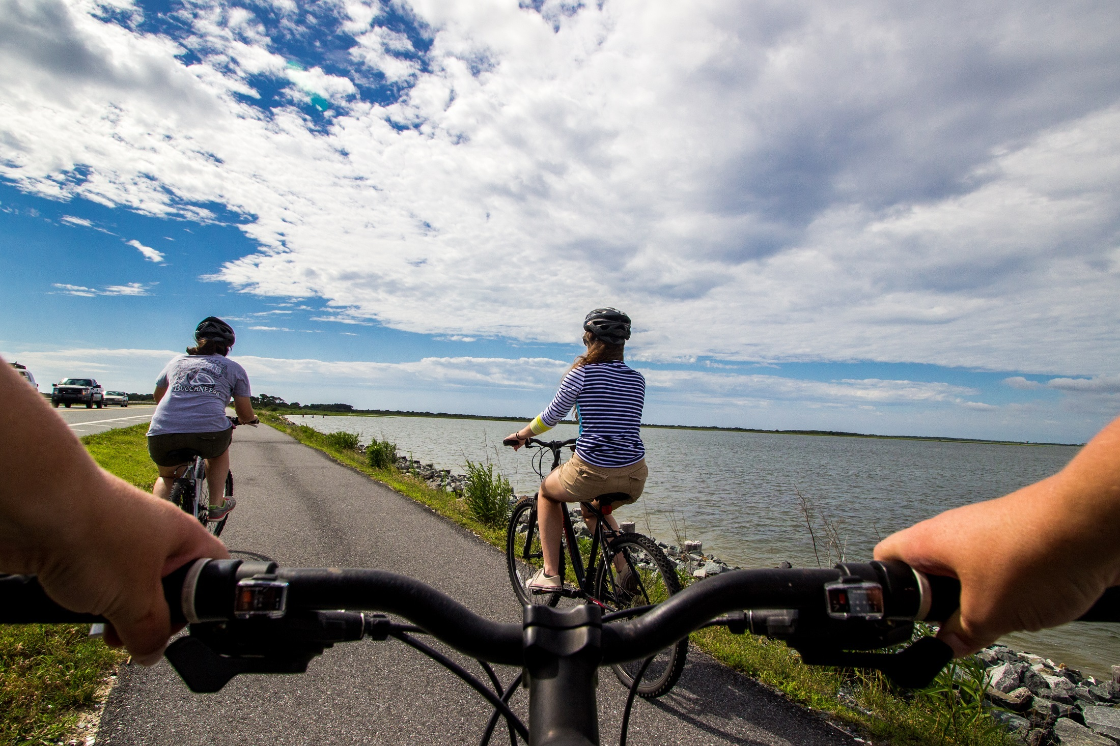 Bicycle Riders riding along the coast.
