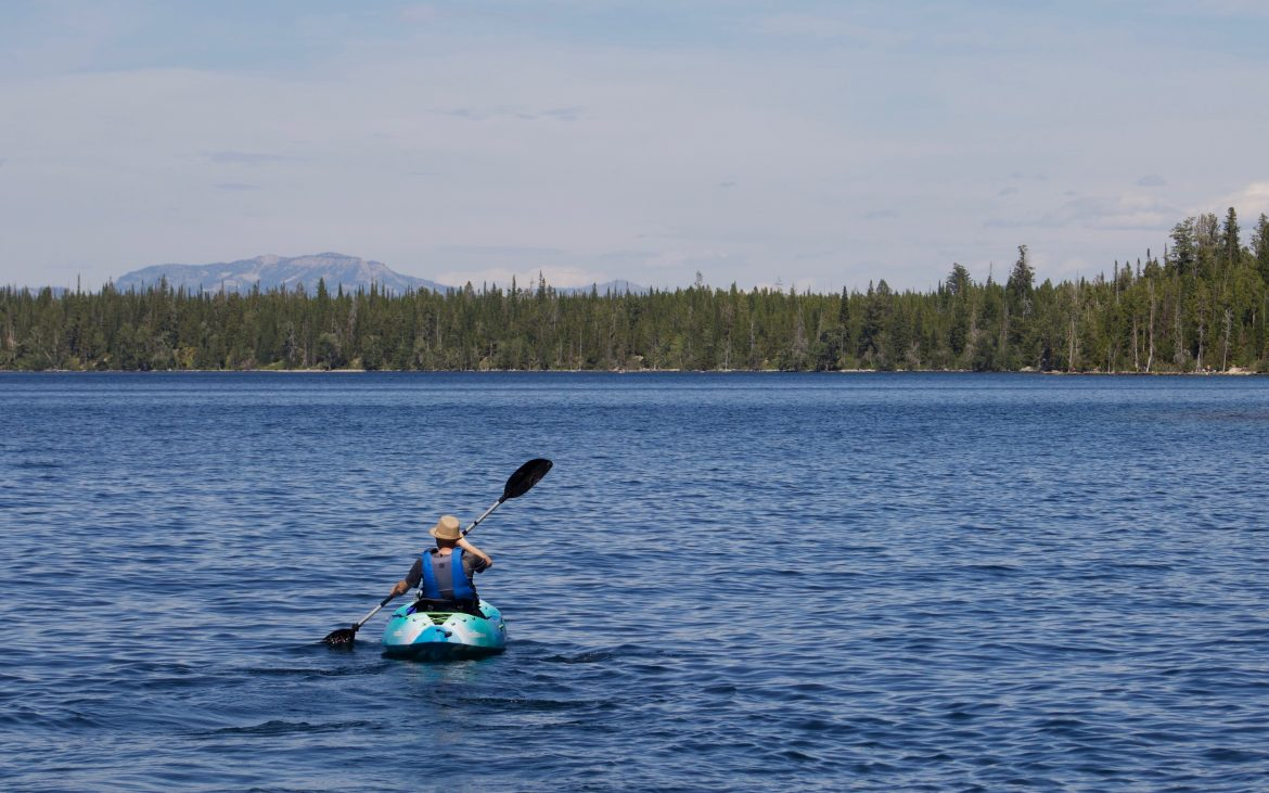 Kayaker on Jenny Lake, Wyoming