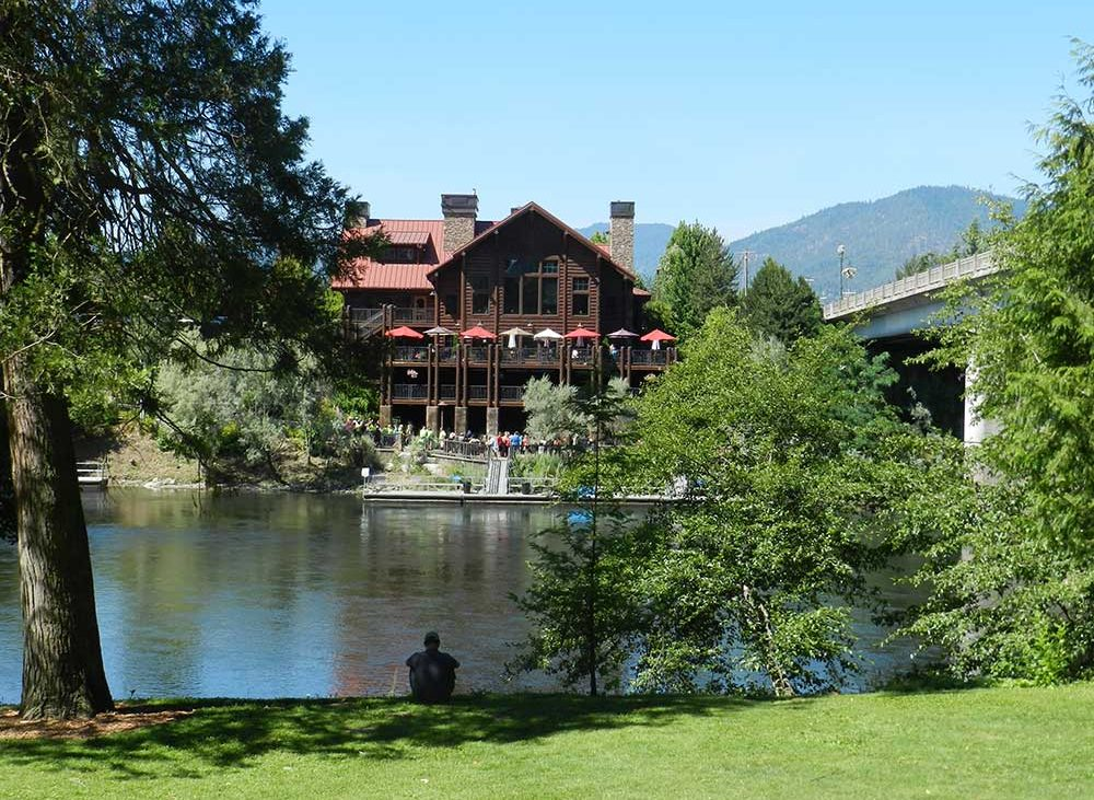 Small lake with large wooden clubhouse at campground in Oregon