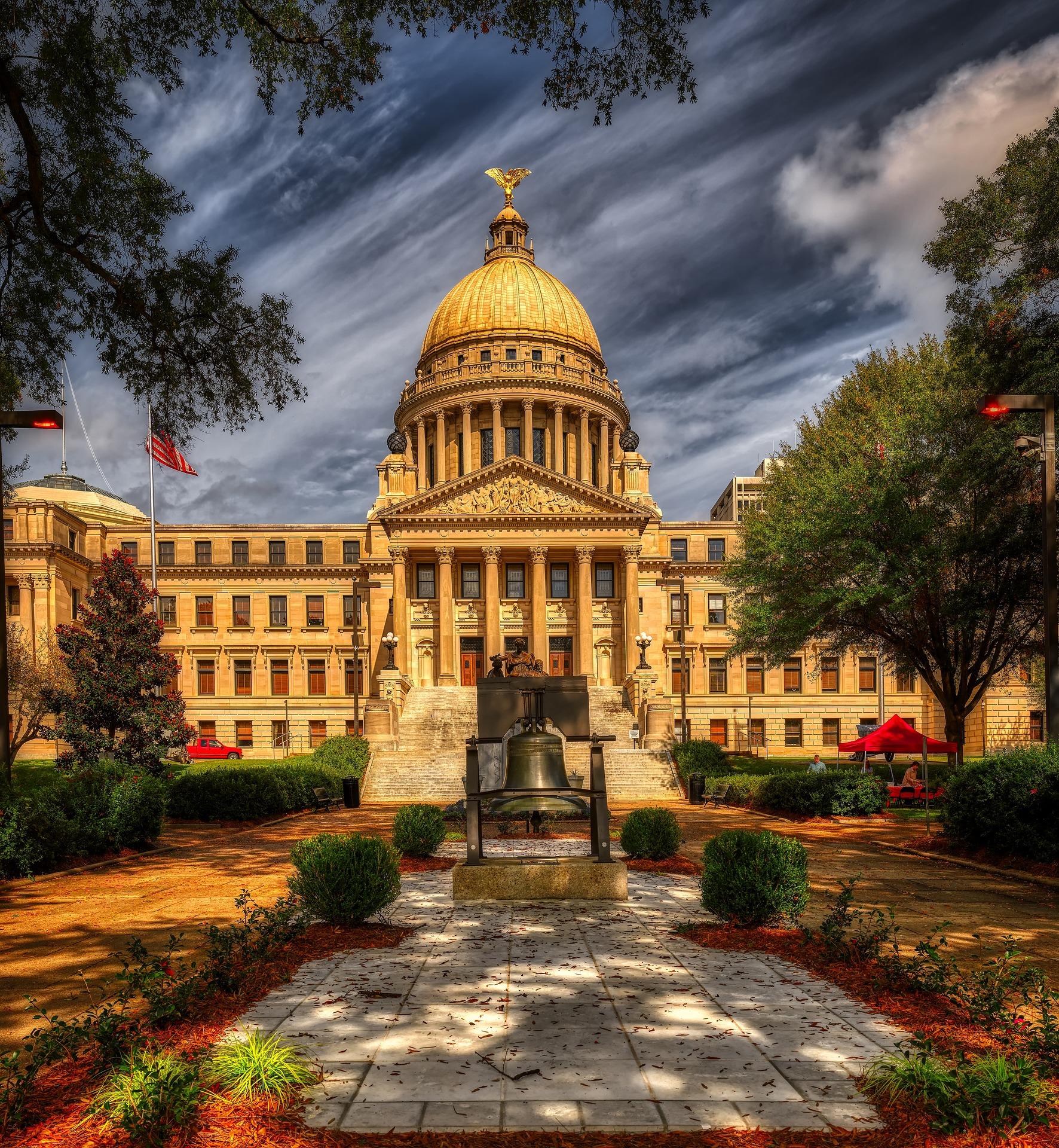 Elegant golden-domed capitol building.