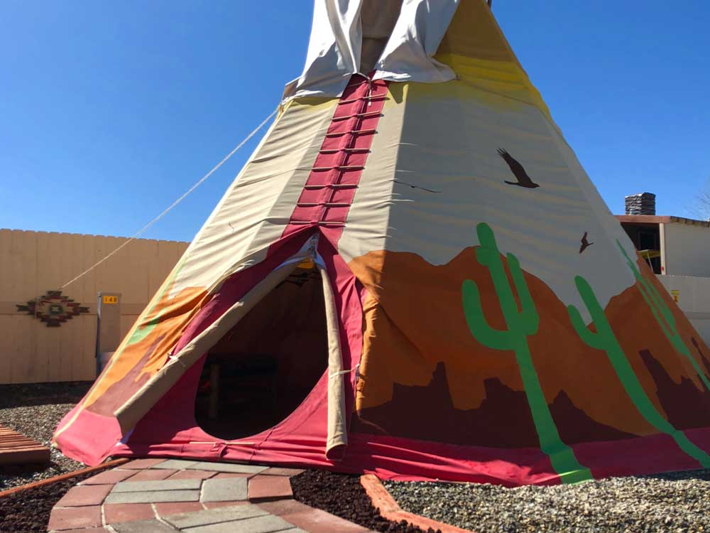 A colorful tepee with cactus designs.