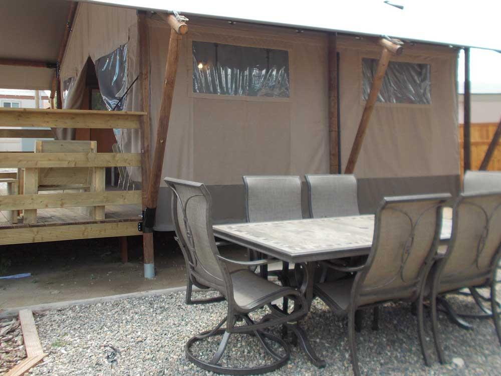 A safari tent on a wooden platform.