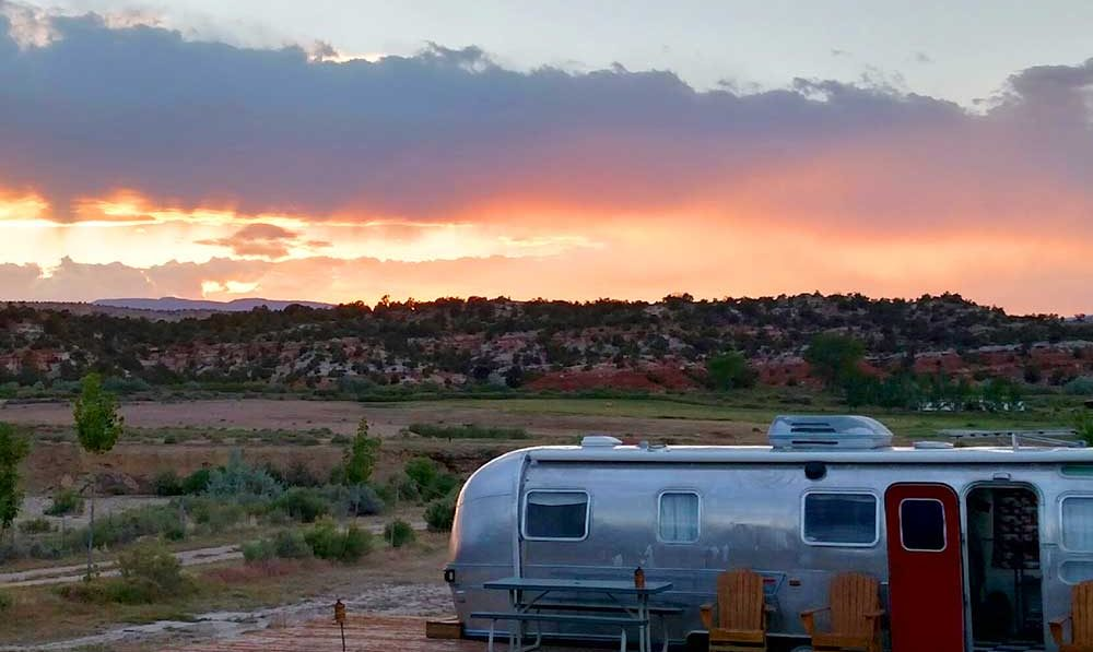 A silver trailer at sunset.