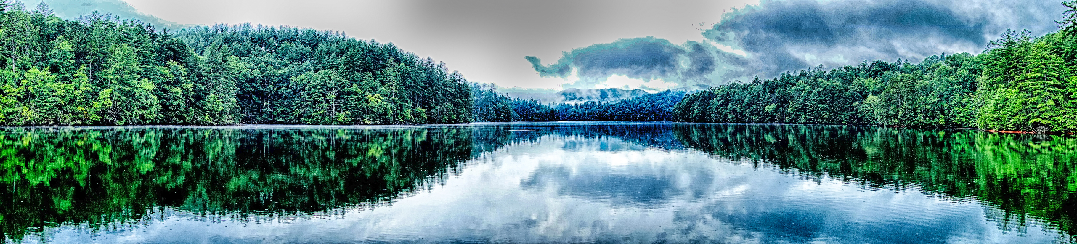 placid lake reflecting clouds