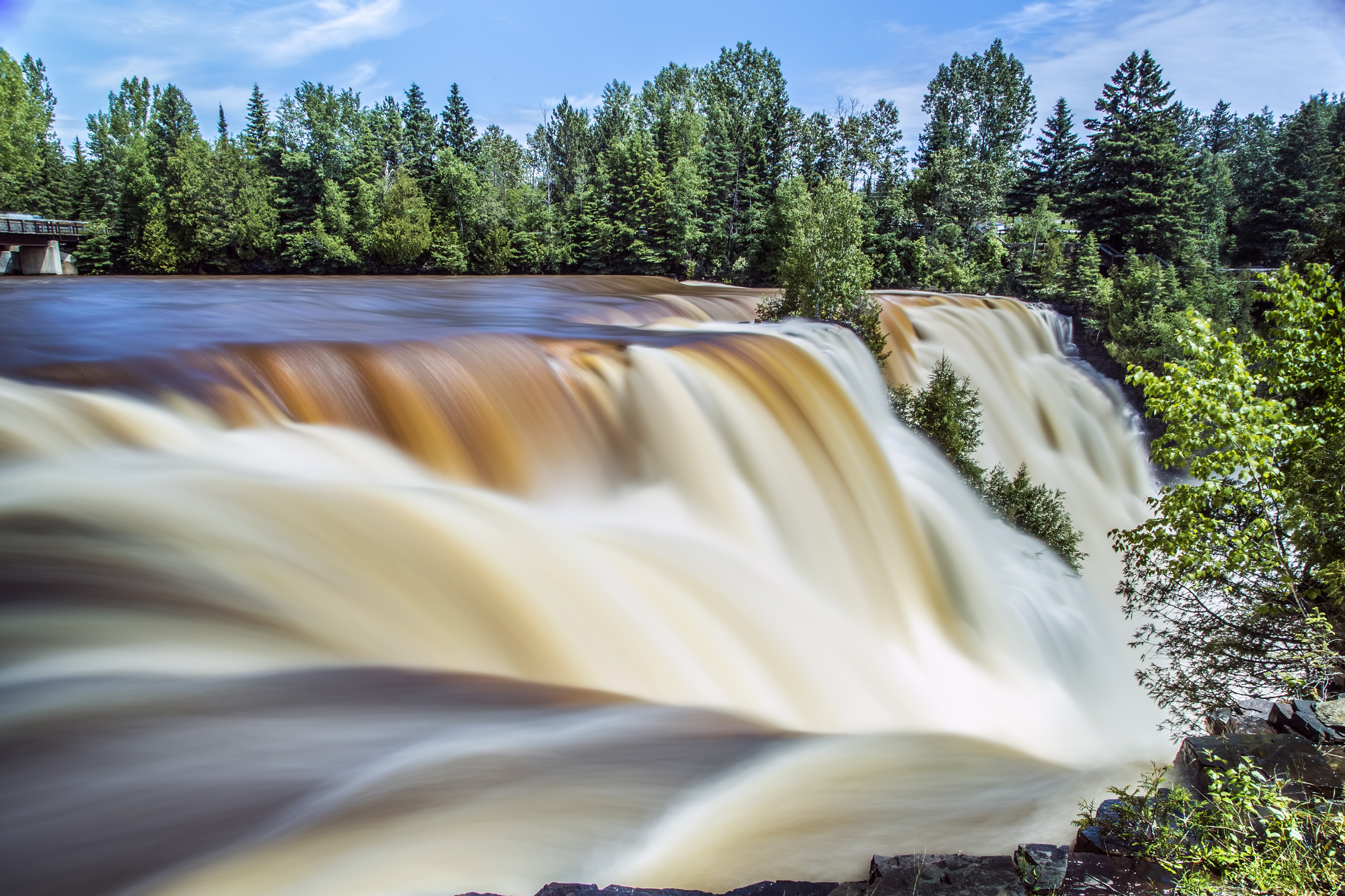 The steady and powerful flow of a waterfall.