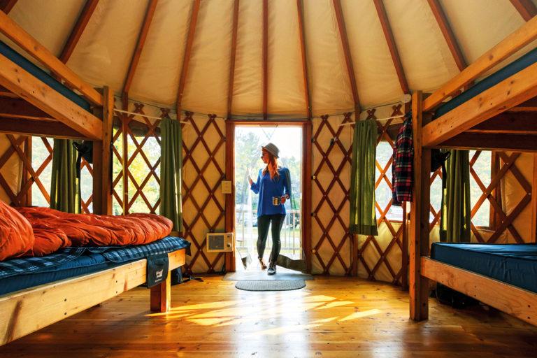 A camper enters a yurt