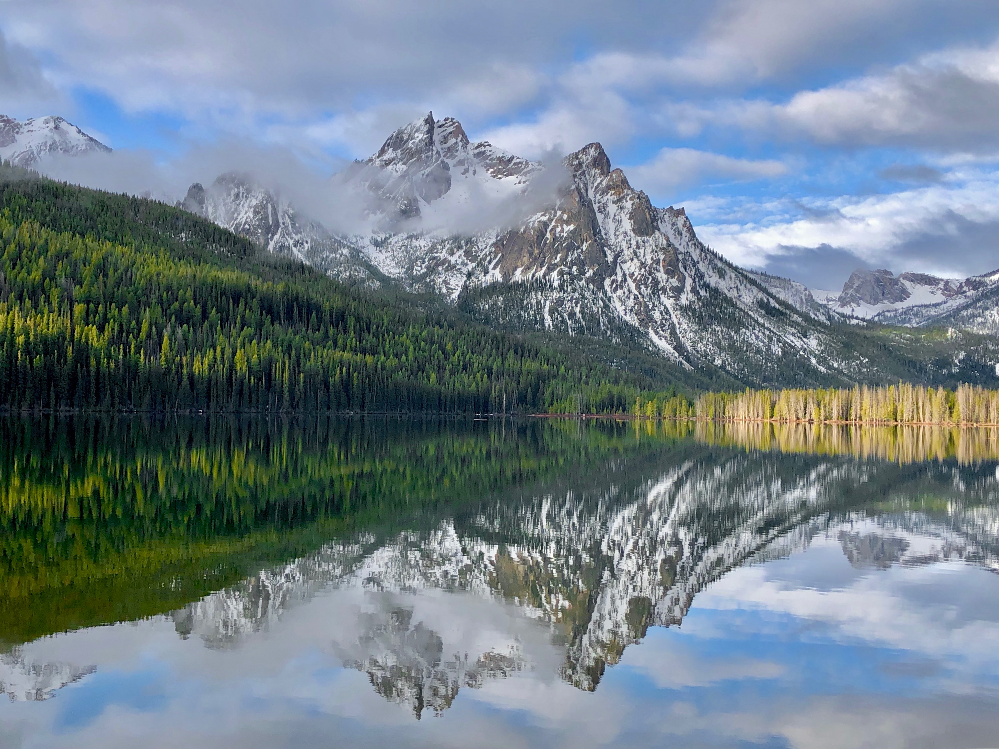 Rugged mountain reflected on lake.