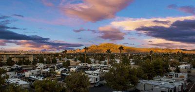 Aerial view of RV park in desert setting.