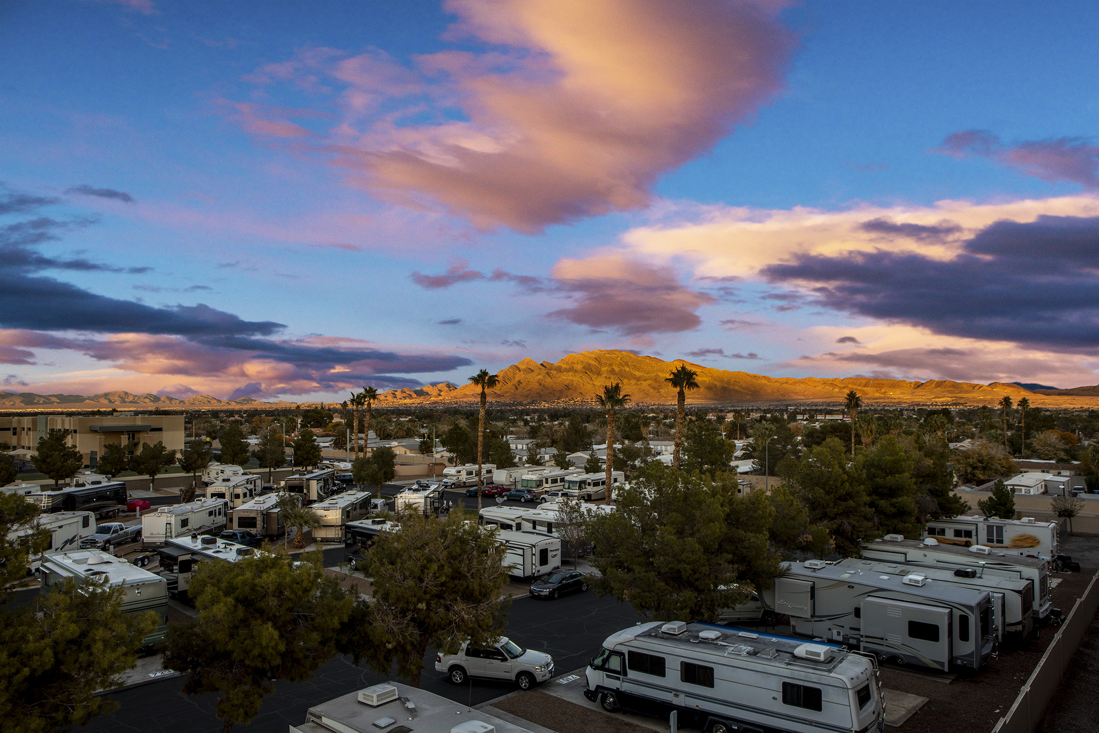 Aerial view of RV park in desert setting.