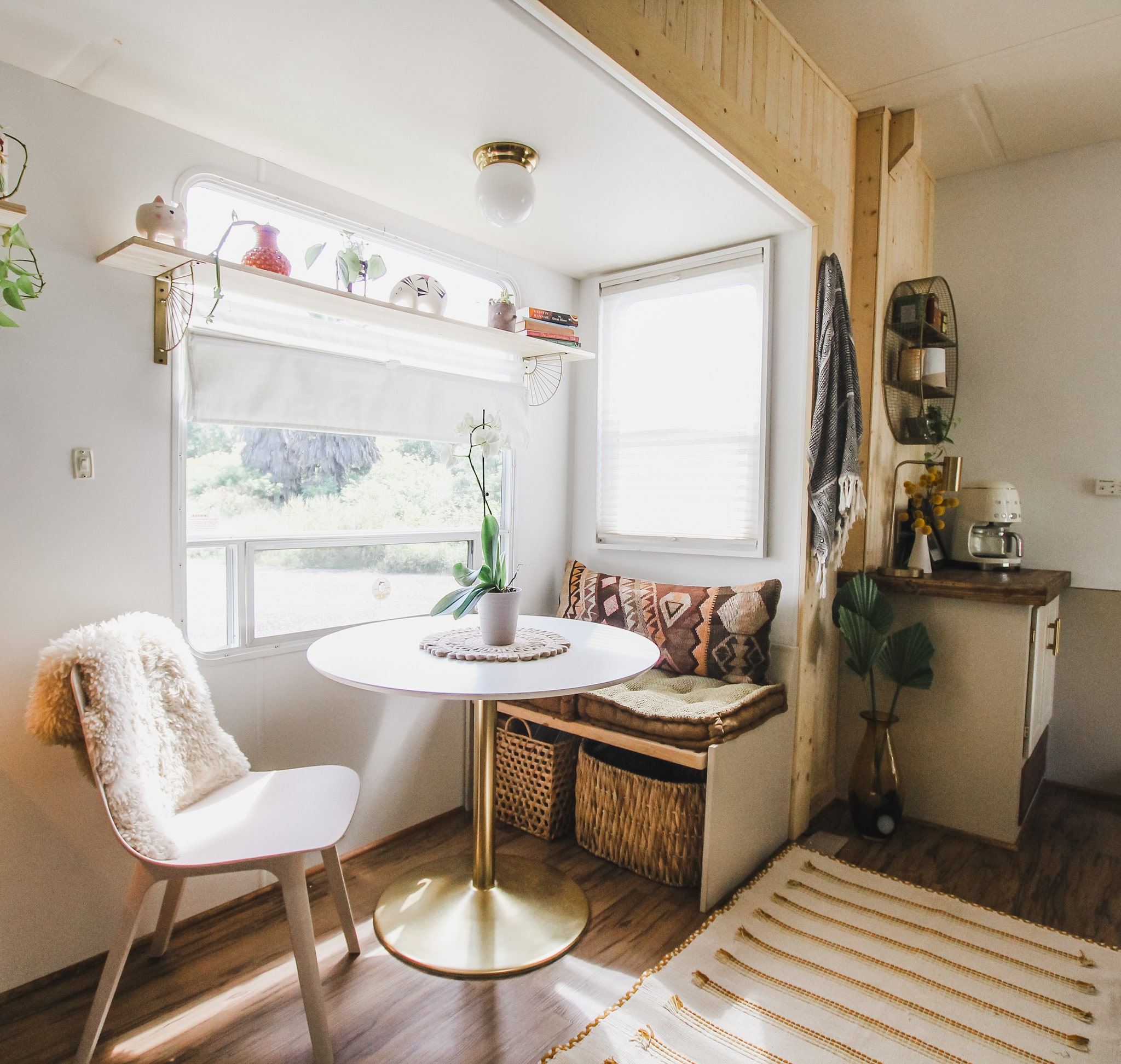 An RV slideout with round table.