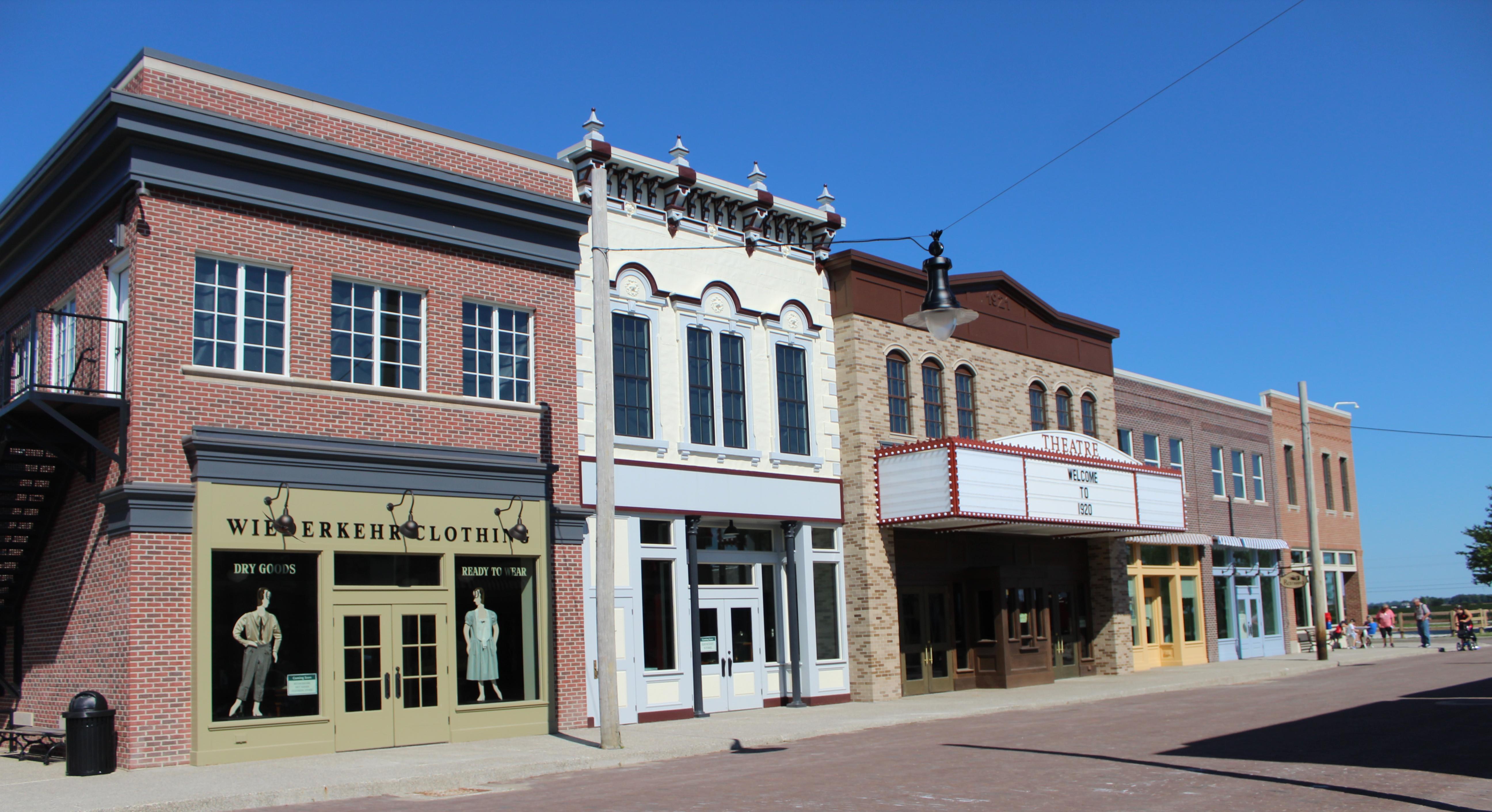 A series of vintage buildings line a 1920s-era Main Street.