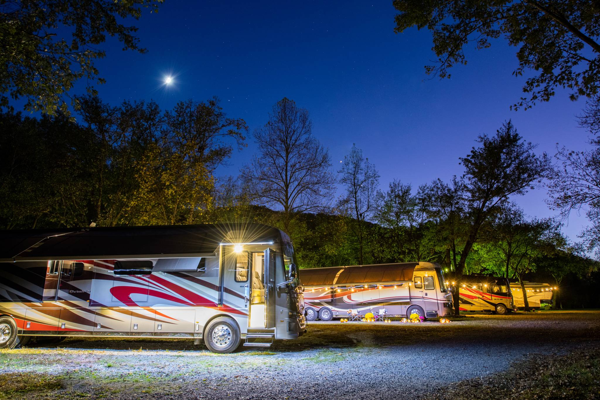 RVs in a resort at night.