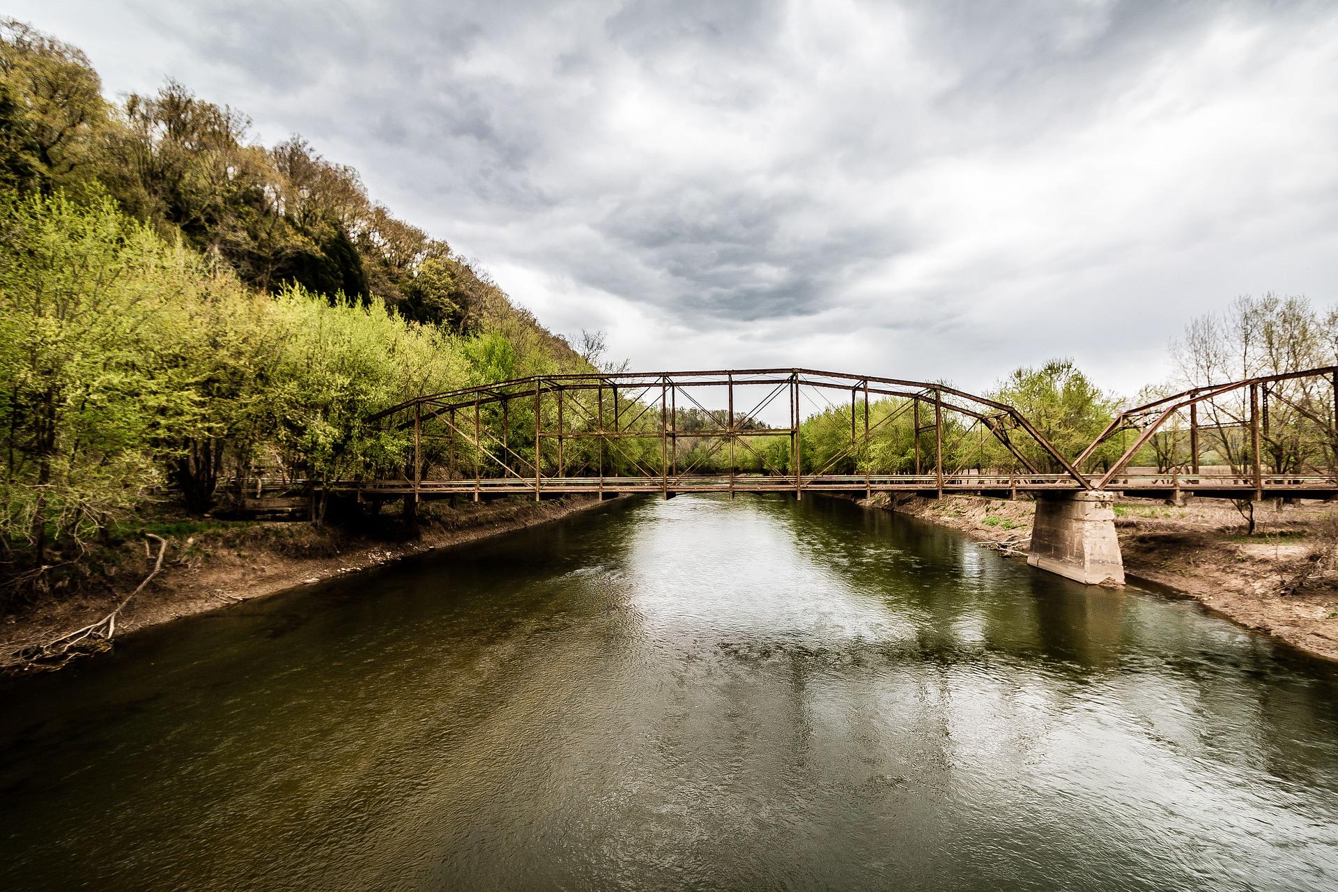 A railroad bridge stretches across a river.