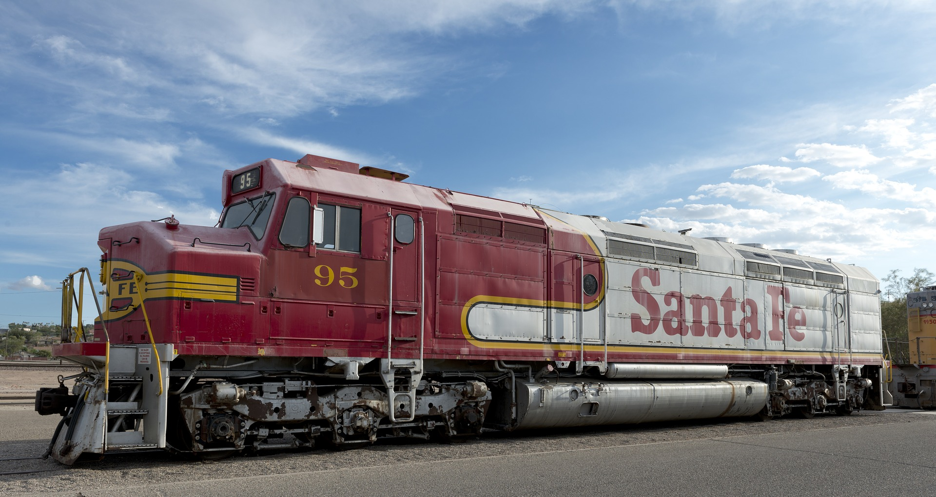 Santa Fe railroad engine on desert tracks.