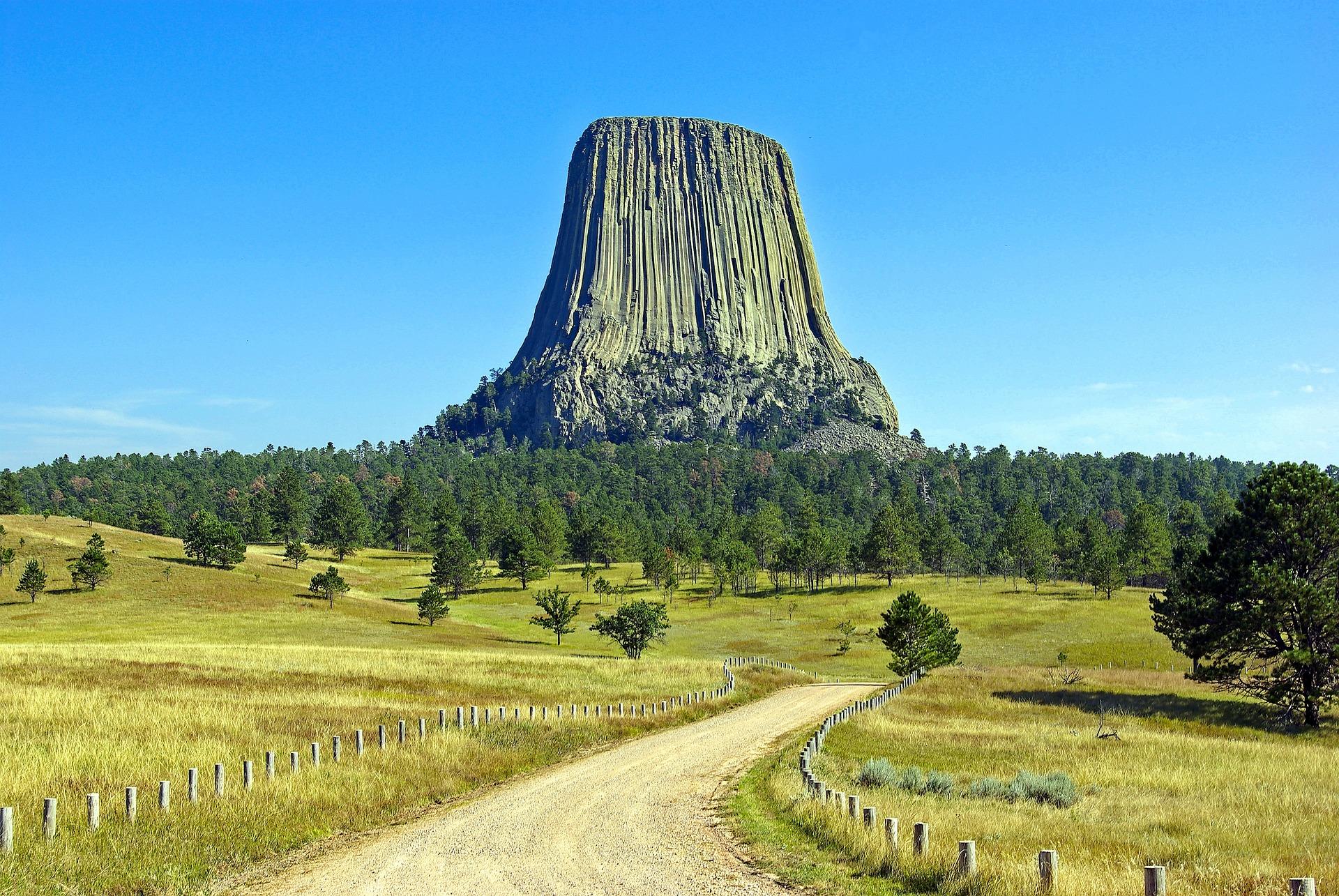 Tree-stump-like stone tower dominates the horizon.