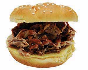 Succulent shredded beef sandwich dripping with barbecue sauce and tempting diners.