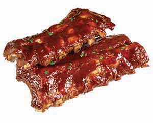 Ribs dripping with reddish barbecue sauce.