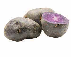 Blue potatoes on display, one cut in half