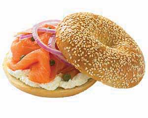 Lochs and cream cheese, onions and caper on a sesame bagel.