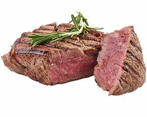 Thick steak topped by a sprig of leaves