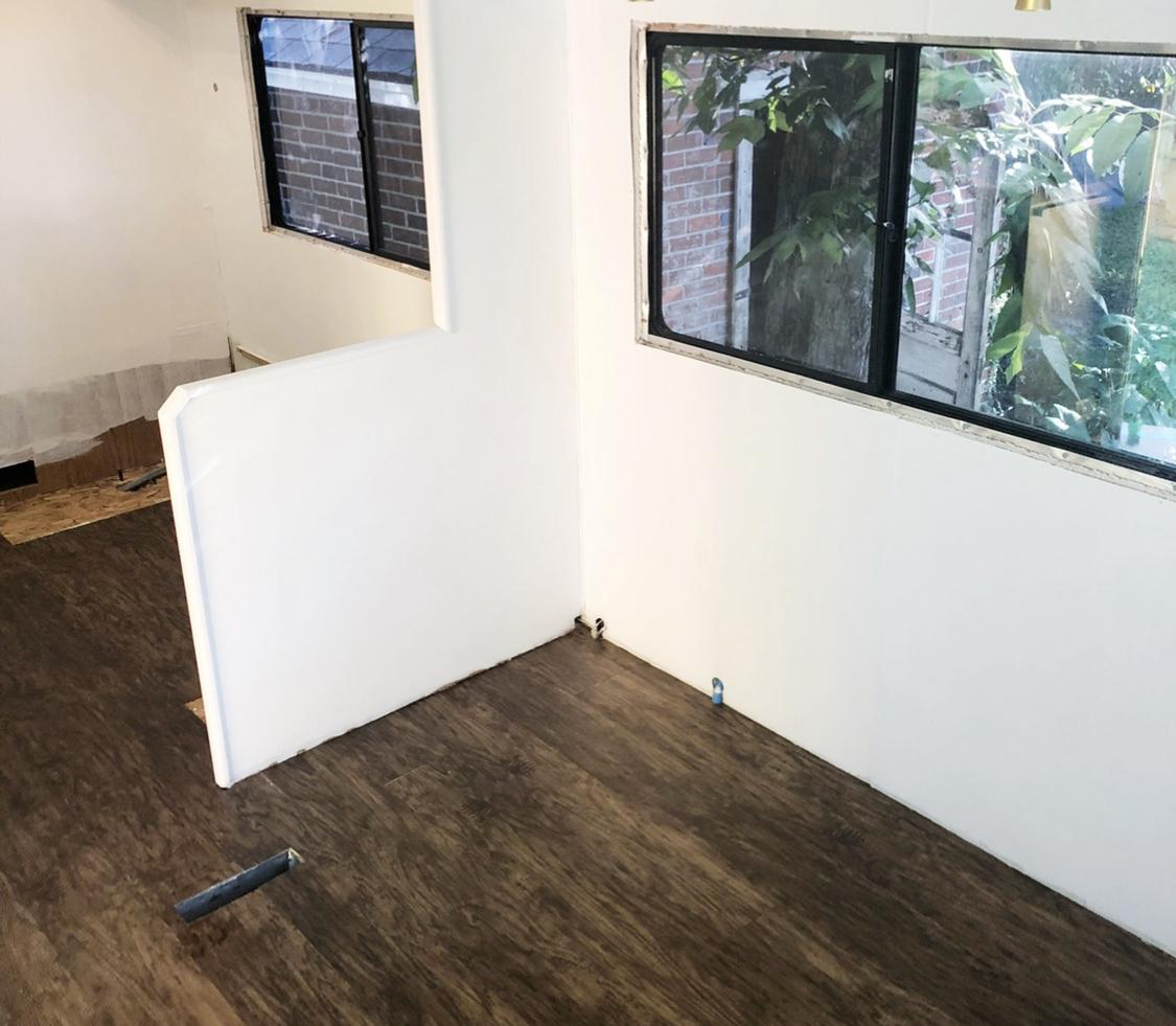Dark, old RV flooring getting removed.