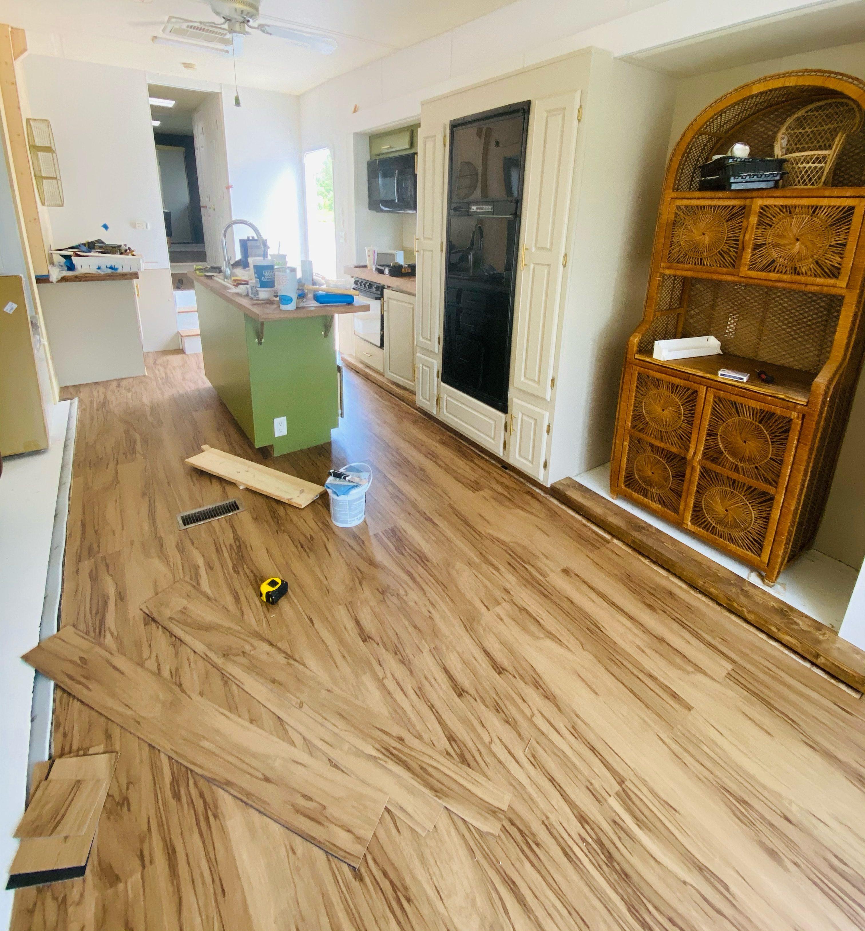 New plank flooring around a kitchen island.