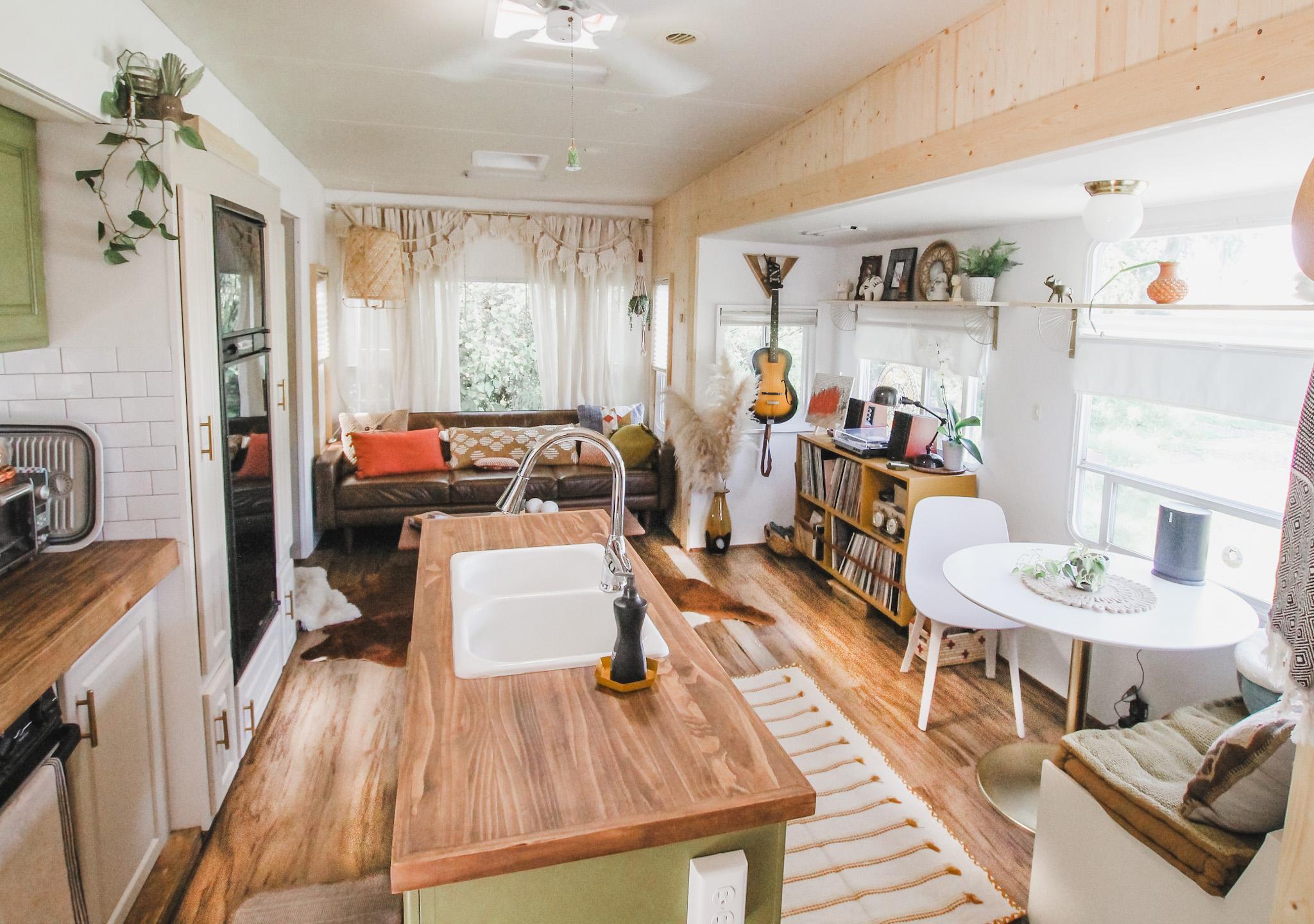 New RV floors around an island kitchen.