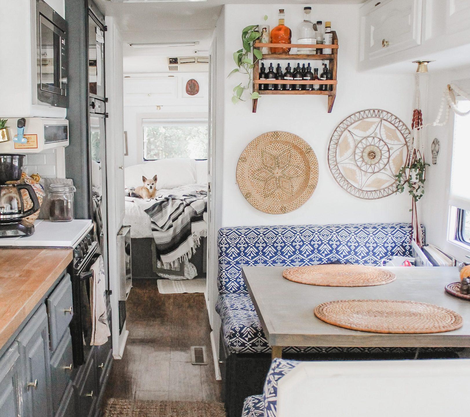 An older, dark laminate floor through an RV kitchen.