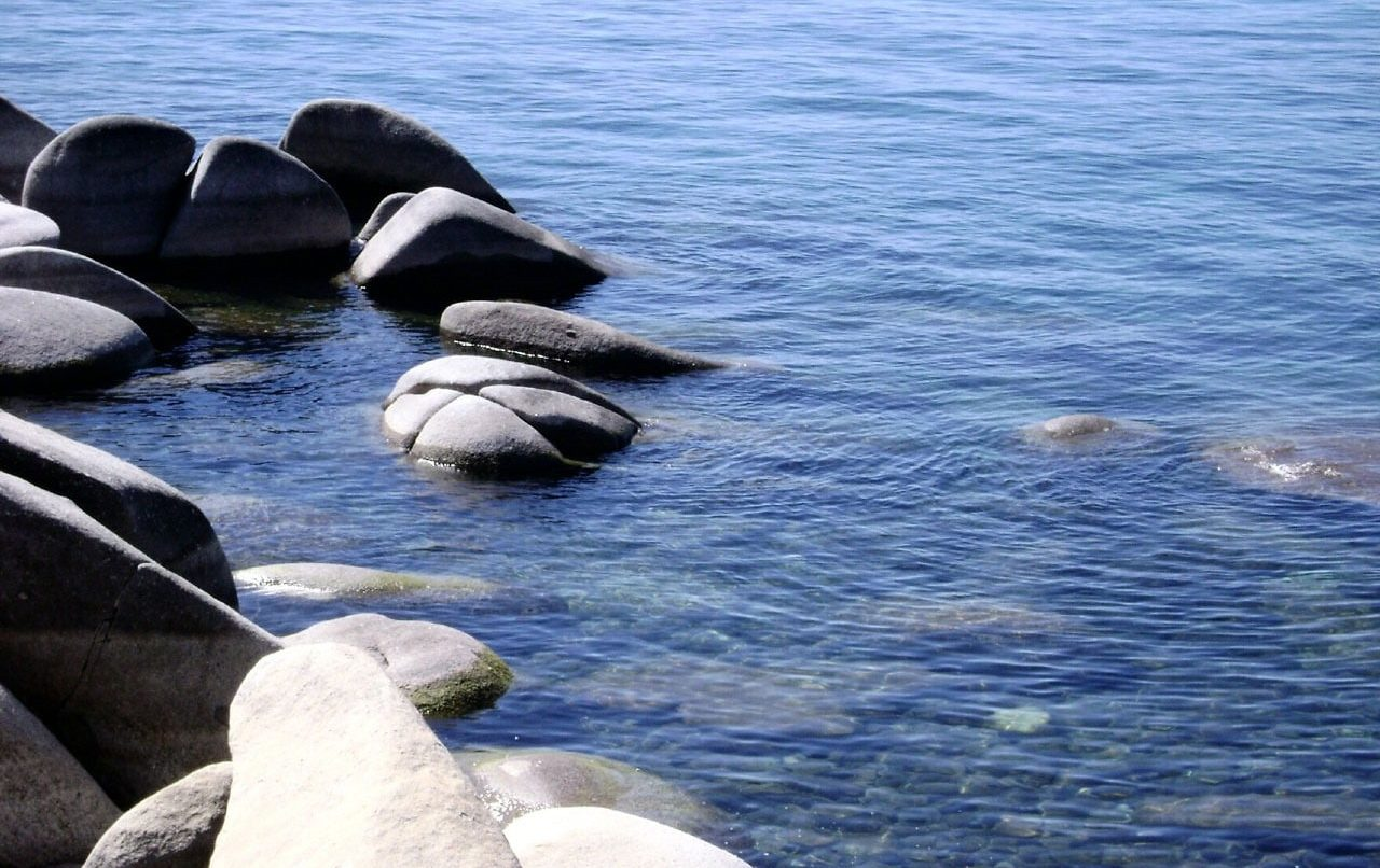 Rocks on the shore of a clear lake