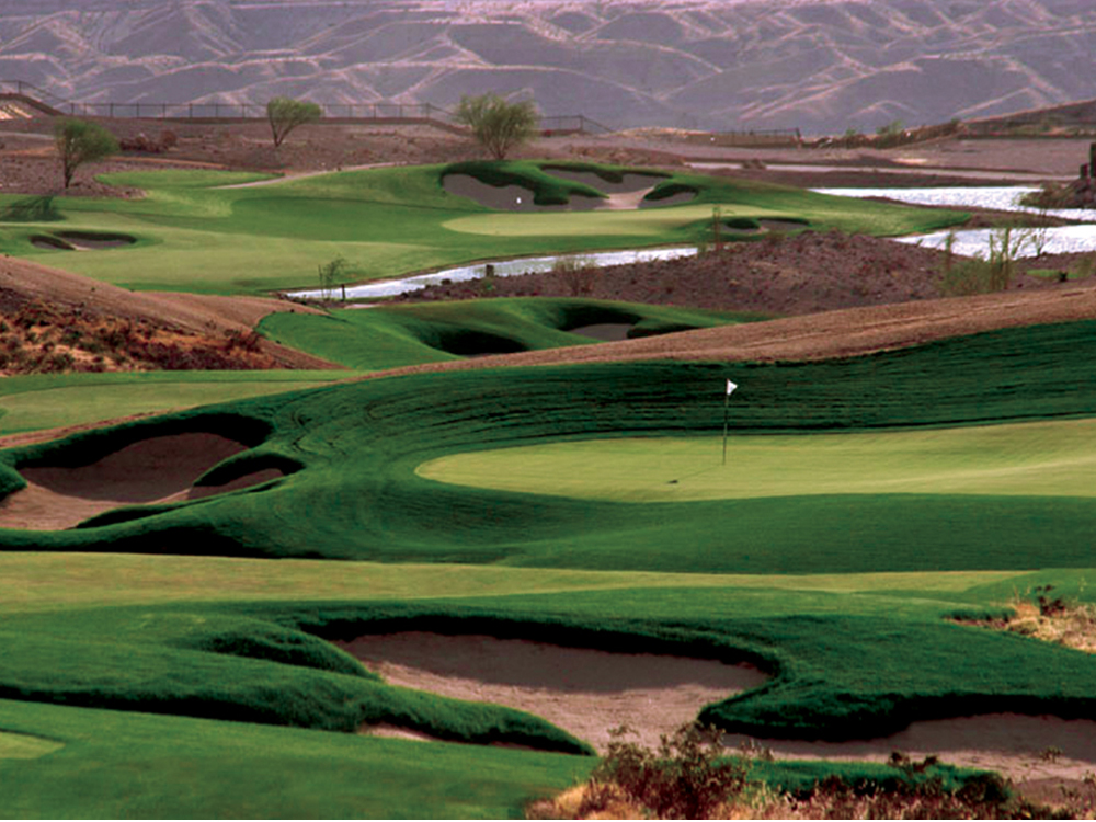 Golf course with undulating fairways, greens and hazards.