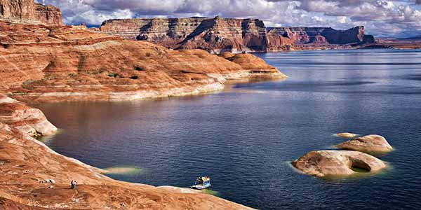 A lone boat on the rocky banks of Lake Powell.