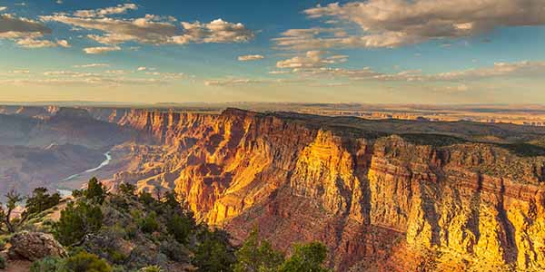 Sheer cliffs of the grand canyon at sunset.