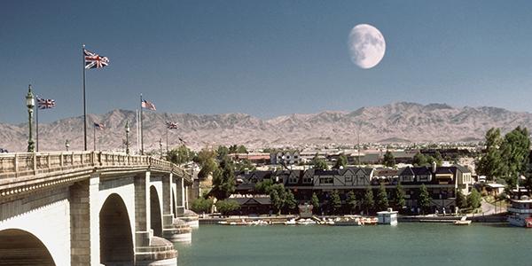 A moon over a stone bridge.
