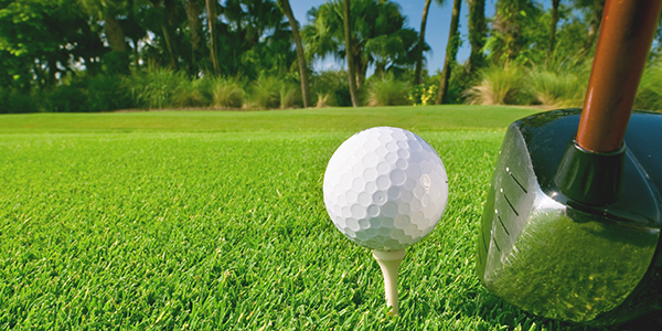 A golf ball and club