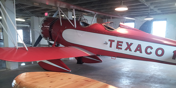 A red and white Texaco airplane