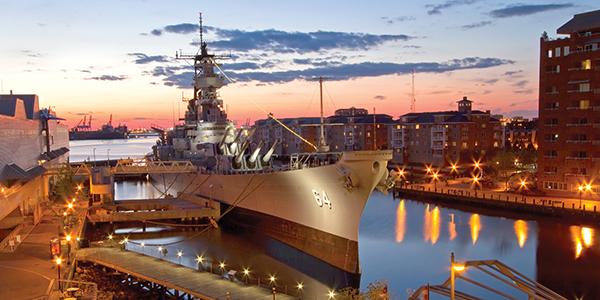 USS Wisconsin Battleship (BB-64) in Norfolk, Virginia, at sunset
