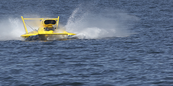 A yellow hydroplane in the water