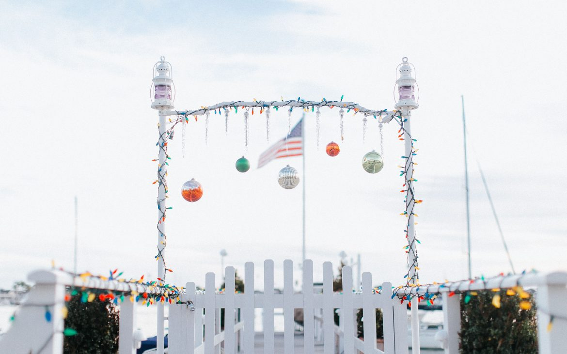 Boat dock at Newport Beach with Christmas decorations, among the top winter destinations.