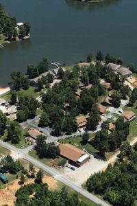 aerial shot of campground on peninsula jutting into lake.